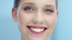 Attractive woman shakes her head ind smiles in camera Stock Footage