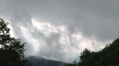 Clouds passing in the early morning hours over the forest that is still asleep Stock Footage