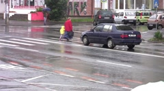 Grandmother with grandson crossing on a pedestrian crossing a street with many Stock Footage
