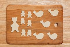 Homemade Cookies in the form of animal figures on the domestic kitchen. Top v - stock photo