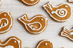 Closeup gingerbread cookies with honey and cinnamon in the form of birds deco - stock photo