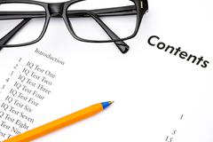 Contents of IQ Tests book with glasses and pen Stock Photos