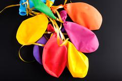 Burst, deflated balloons - stock photo
