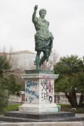 Low angle view of statue with graffiti at park Stock Photos
