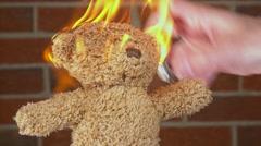 Teddy bear burning close up on head 4k Stock Footage