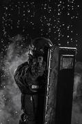 police officer with ballistic shield - stock photo
