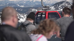 Gondola Leaving Station With People in foreground/Tight Shot Slow Motion Stock Footage