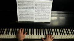 Female hands playing on beautiful grand piano. - stock footage