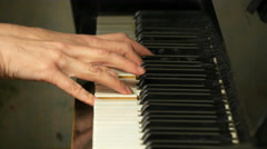 Female hands playing on a beautiful piano. - stock footage