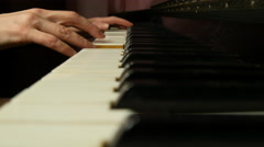 Woman playing the piano, close-up. - stock footage
