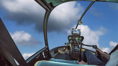Helicopter in cloudy sky - stock footage