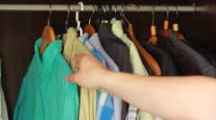 Man Choosing Clothes To Wear in Closet - stock footage