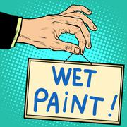 Hand holding a sign wet paint - stock illustration