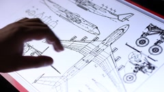 Technical drawing of airplane on touch screen computer Stock Footage
