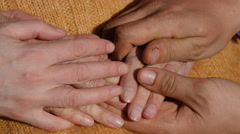 Male and female hands comforting a old pair of hands outdoor. Stock Footage