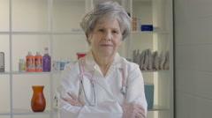 Portrait of an older female Medical Doctor Stock Footage