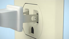 A  pronged electric plug is inserted into a receptacle. Stock Footage