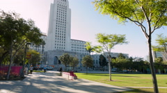 Wide tilt up to Los Angeles City Hall with traffic and pedestrians 4K Stock Footage