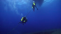 Chaotic hoard of scuba divers ascending in bluewater in Australia, HD, UP20431 Stock Footage