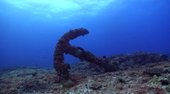 Ocean scenery huge admiralty anchor, surge, on rocky reef, HD, UP20438 Stock Footage