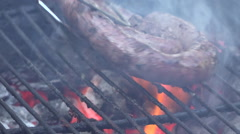 Slow Motion turning of traditional braai barbecue boerewors sausage Stock Footage
