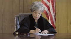 Judge taking notes in the courtroom Stock Footage