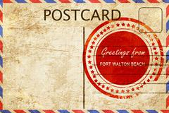 fort walton beach stamp on a vintage, old postcard - stock illustration