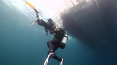 Buddy team of scuba divers making a safety stop on water surface, HD, UP20577 Stock Footage