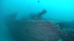 Ocean scenery swim across deck through poor visibility to reveal two divers on - stock footage
