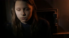 Young teen girl in the dark, UHD 4K Stock Footage