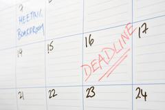 Deadline written on calendar - stock photo