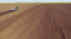 Aerial view of tractor plowing the fields, movement for tractor Stock Footage