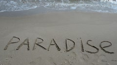 """Inscription """"Paradise"""" in the sand on a tropical island, Stock Footage"""