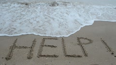 Help Sign on the sand of tropical sea beach Stock Footage