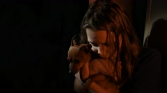 Young teen girl in the dark with a little doggy, UHD 4K - stock footage