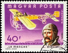 French aviator Louis Bleriot and his airplane on postage stamp - stock photo