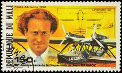 "French aviator Jean Mermoz and hydroplane ""Croix du Sud"" on postage stamp Stock Photos"