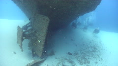 Ocean scenery divers approach rudder, on wreckage, HD, UP20812 Stock Footage