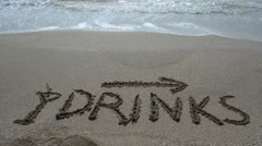 Inscription Drinks and the arrow drawn on the beach sand with a soft transparent - stock footage
