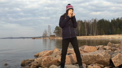 Girl beautifully dances standing on stones near the gulf Stock Footage