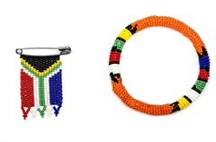 Zulu Beads Threaded into an Armband and a South African Flag - stock photo