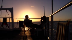 Divers relaxing on deck, HD, UP20908 Stock Footage
