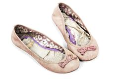 Pair of Pink Girls Tattered Worn-out Shoes - stock photo
