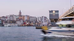 Stock Video Footage of Busy traffic of ships under the Galata Bridge at night.