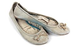 Pair of Blue Faded Worn-out Pair of Shoes Stock Photos