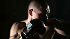 Boxer exercising punching with boxing gloves Stock Footage