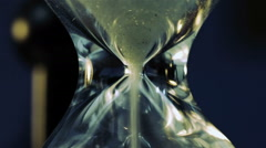 Sand Flowing Through An Hourglass - stock footage
