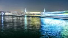 Movement of ships under the  Ataturk Bridge at night. Istanbul, Turkey. Stock Footage