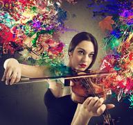 Beautiful violinist - stock photo