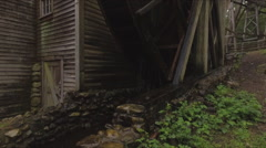 Aerial of Bale Grist Mill with large water wheel - stock footage